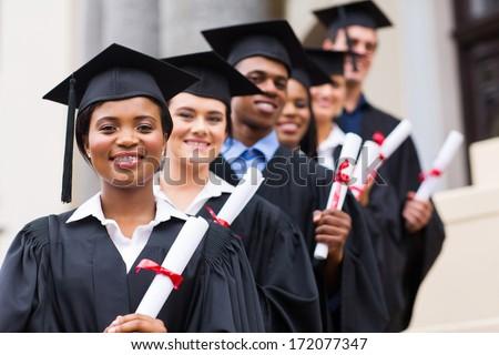 happy group of university graduates at graduation ceremony