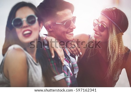 Happy group of young people having fun and enjoying festival in summer #597162341