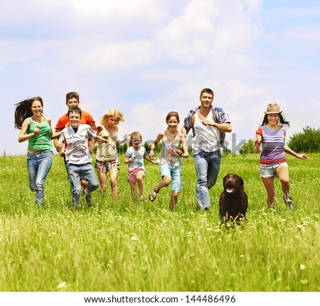 Happy group people summer outdoor with dog.