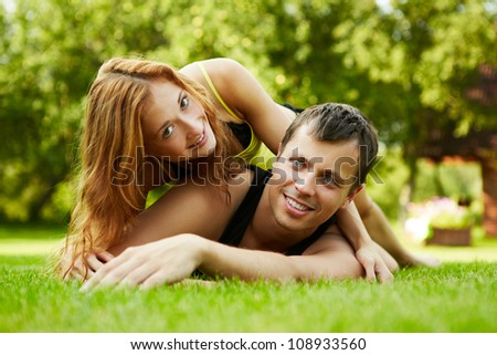 Happy guy and the girl on a grass