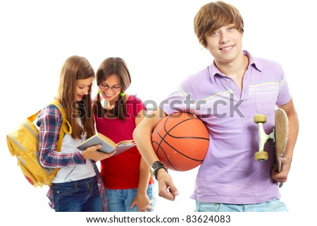 Happy guy with ball and skateboard on background of two reading girls
