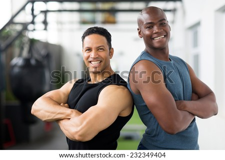 happy gym trainers with arms crossed