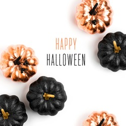 Happy Halloween Card. Stylish  background with black and gold Halloween pumpkin. isolated on white background. Flat lay, top view.