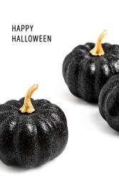 Happy Halloween Card. Three Black Shiny Decorative Pumpkins. Minimal creative stillife