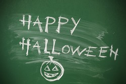 Happy Halloween chalk board Holiday message.  Hand written