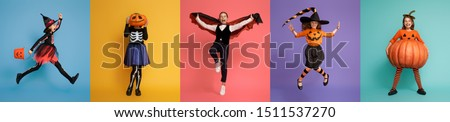 Happy Halloween! Children in carnival costumes on multicolor background.