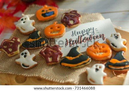 happy halloween concept funny homemade halloween cookies with happy halloween card on wooden tray and