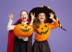 Happy Halloween! Cute little witch and Dracula with a pumpkin on violet background.