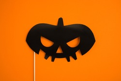 happy halloween eye mask black pumpkin scary face on orange background