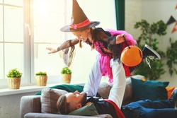 happy Halloween. family father and daughter child play in house costumes