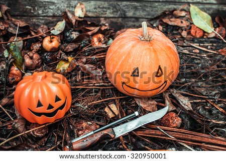 Happy Halloween. Holiday pumpkins and decorations. Pumpkin on autumn street. Preparations for the holiday decoration bats and manufacturing Hallowe\'en pumpkin