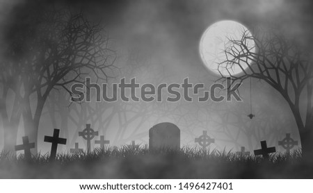 Happy Halloween in creepy forest at horror night on graveyard.