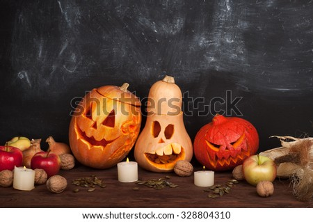 Happy Halloween; Jack-o-lantern on a dark background; pumpkin; candles; Still Halloween