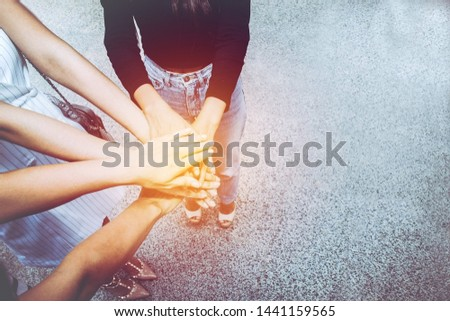 Happy hand coordination of the group of female businesswoman wearing all three private suits for success in work and unity in the team : Copy Space    #1441159565