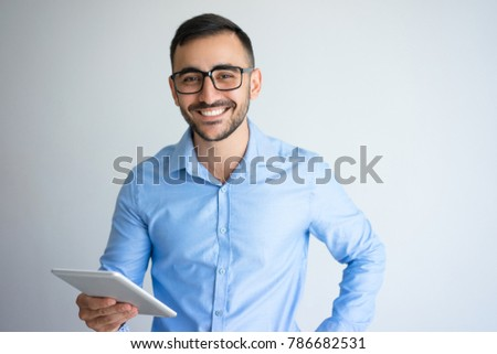 Happy Handsome Business Man Holding Tablet #786682531