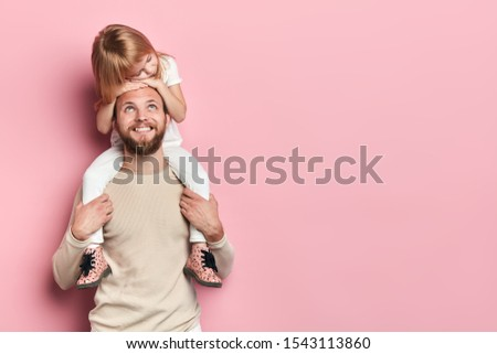 happy handsome daddy looking at his little adorable girl who is sleeping on his shoilders, redt time, free time, spare time. close up portrait, isolated pink background, studio shot