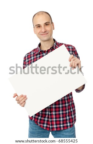 happy handsome young man holding blank white card over white background