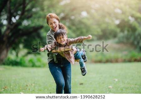 happy harmonious family outdoors concept.mother and son have activities together on holidays.