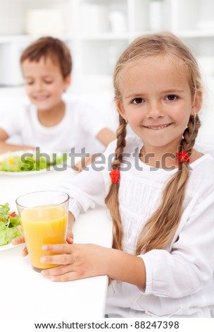 Happy healthy kids eating fresh food - closeup - stock photo