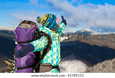 Happy hiker girl with backpack