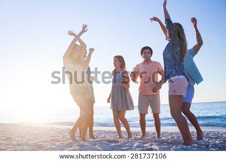 Happy hipsters drinking beer at the beach