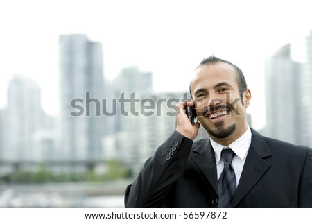 Happy Hispanic business man on Phone