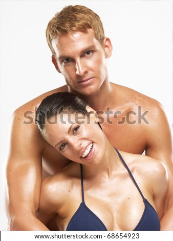 Happy hispanic couple after bath-spa. Hispanic couple on white background.