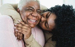 Happy Hispanic mother and daughter having tender moment together - Parents love and unity concept