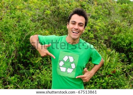 Happy hispanic volunteer wearing a green recycling shirt