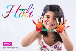 Happy Holi Greeting - Cute little Indian girl with colourful hands, isolated over white background