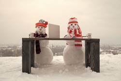 Happy holiday celebration, new technology. Snowman in winter with laptop, headset and book. New year snowman in hat. Xmas or christmas decoration, audio book. Christmas and education, fairytale.