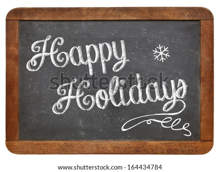 Happy Holiday - white chalk handwriting on a vintage slate blackboard isolated on white