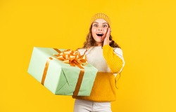 Happy holidays. Xmas gift shopping. Gift package. Cherished dreams. Boxing day. Teen girl hold gift box. Kid hold present box yellow background. Purchase and delivery. Shopping mall. Birthday girl.