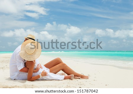 Happy honeymoon vacation at Paradise. Couple relax on the white sand of beach. Happy sea lifestyle. Young family, man and woman rest on the beach of ocean. Couple in love travel to island. Love travel Foto stock ©