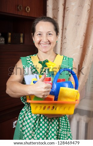 Happy Housewife with cleaning supplies