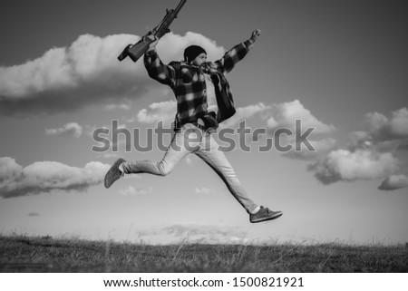 Happy hunter. Hunter with shotgun gun on hunt