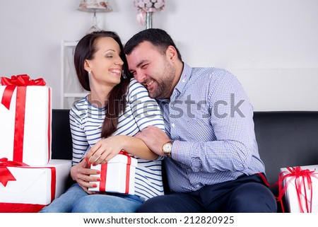 happy husband and wife. give gifts. emotions, happy family, holidays