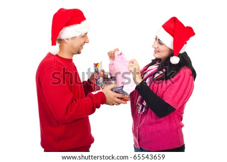 Happy husband receive a surprising Christmas gift from his wife,they will be parents - stock photo