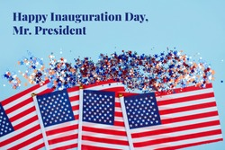 Happy Inauguration Day, Mr.President - creative composition with USA flags on blue background and copyspace for text. Inauguration Day 2021 concept