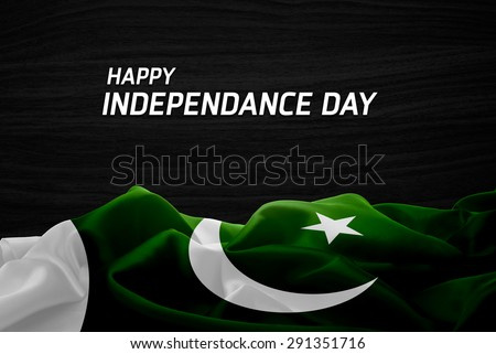 Happy Independence Day Pakistan flag and wood background #291351716