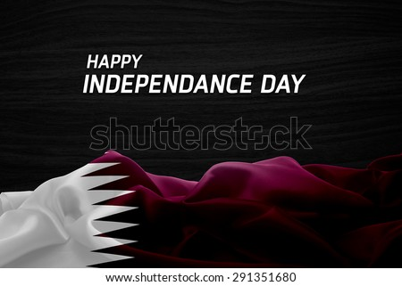 Happy Independence Day Qatar flag and wood background #291351680
