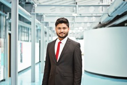 Happy indian business man in suit