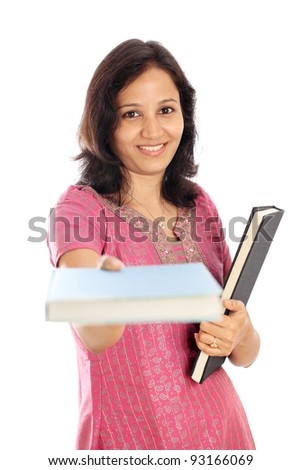 Happy Indian college student holding text books