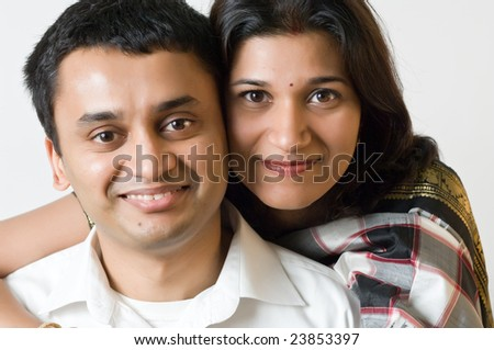 Happy Indian ethnicity couple posing.