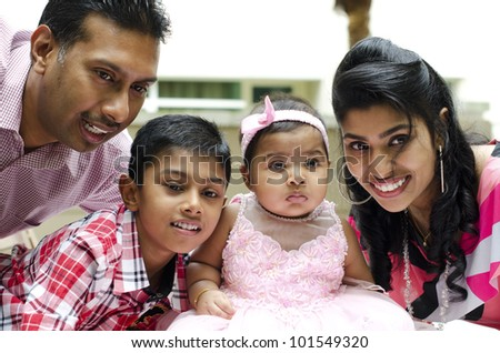 Happy Indian family having fun time at outdoor