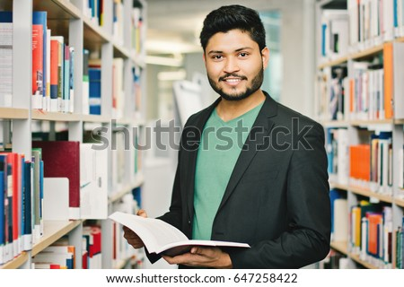 Shutterstock Happy indian male student at the library