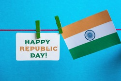 Happy Indian Republic Day 26 January concept. India flag (heart color) hanging on pegs ( clothespin ) with text Vande Mataram in national tricolour flag and ashoka. Toned image