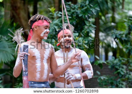 Happy Indigenous Australians men hunting in a rain forest Queensland, Australia. #1260702898