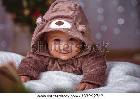 Happy infant baby boy in christmas decorations closeup