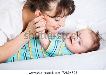 Happy infant smiling and his mother